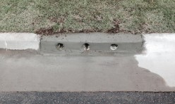 Drainage Pipes in Concrete Curb After